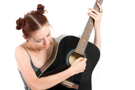 Woman playing acoustic guitar on white background photo