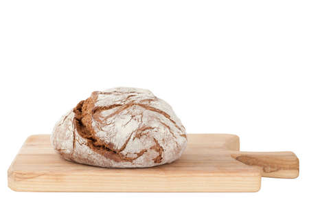 Homemade bread on wooden cutting board isolated on white background Stock Photo