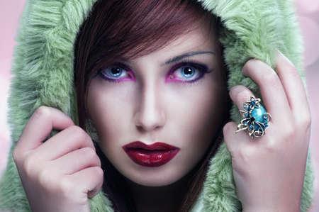avantegarde: Cute brunette wearing hood Stock Photo
