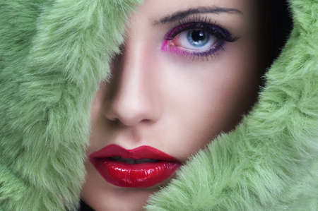 Portrait of young beautiful woman with green fur  photo