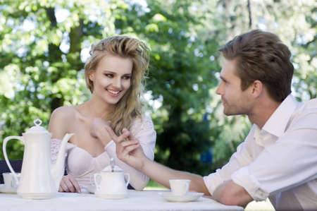 Young couple enjoying lunch in the garden photo