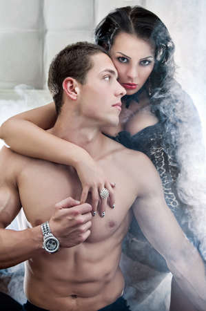 mistress: Sexy couple in romantic pose Stock Photo