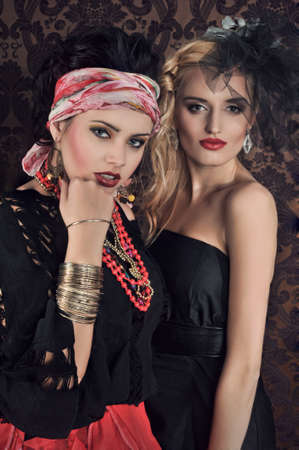 gypsy woman: Portrait of gorgeous gypsy woman with another women