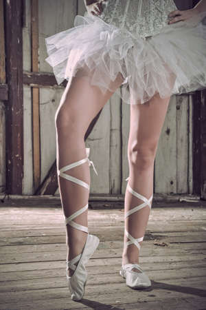 Beauty legs of ballerina standing in pointes photo
