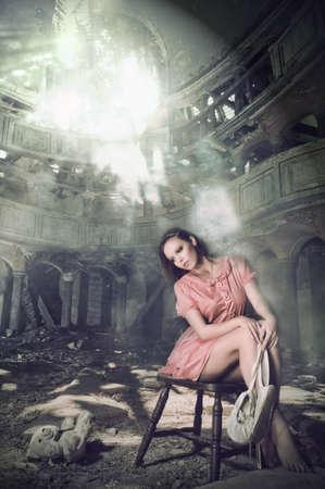 pensive girl dreams of ballet in theatre photo