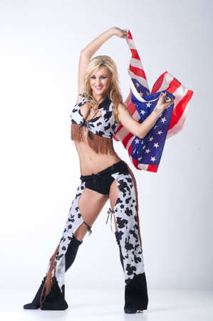 Cowboy girl with american flag  photo