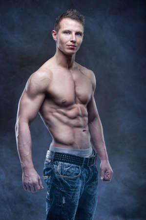 naked abs: Good looking bodybuilder posing