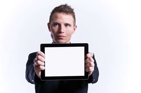 Businessman holding blank digital tablet with clipping path for the screen photo