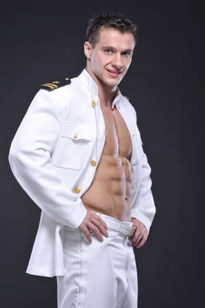 A man dressed as a pilot on grey background photo