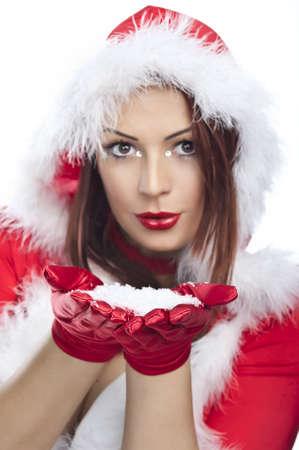 Happy friendly woman blowing snowflakes in winter season Stock Photo - 17257409