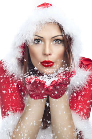 Beautiful young woman in Santa Claus clothes isolated photo