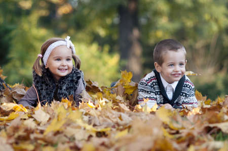 Little boy and girl laying down on grass Stock Photo - 17257415