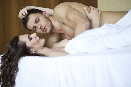 Top view of playful young couple enjoying in bed Stock Photo