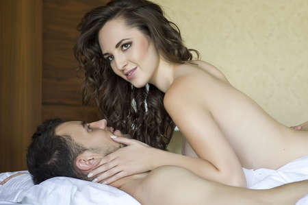 hot sexy girls: Top view of playful young couple enjoying in bed Stock Photo