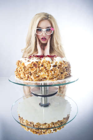 anniversary sexy: Beautiful blonde woman with a cake  Sweet sexy lady with glasses  Stock Photo