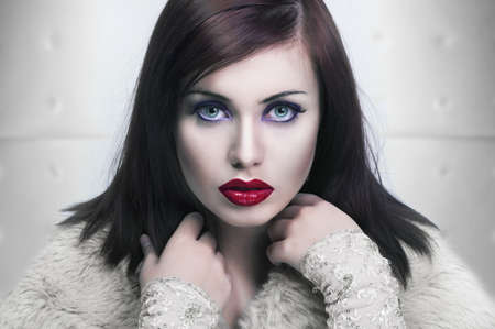 Cold portrait of a young lady with red lips photo