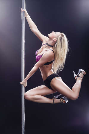 Young sexy pole dance woman Stock Photo - 17758448