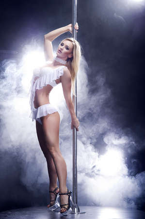 sensuality: Young sexy pole dance woman  Stock Photo