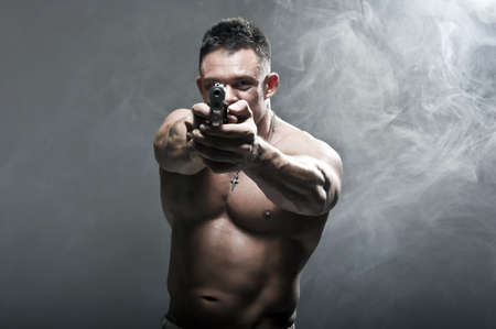 Serious Male Holding a Gun photo