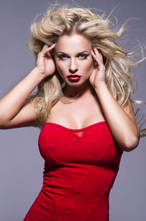 Portrait of beautiful blonde woman with red lips and curly hairs photo