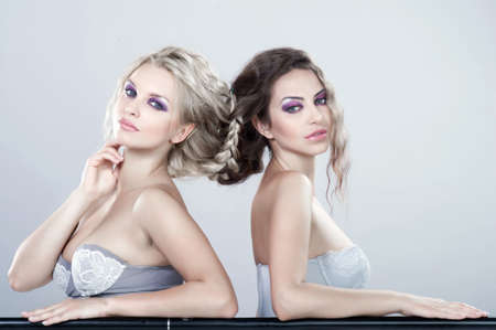 Portrait of a two beautiful sexy young women  Connected to the hair Stock Photo - 19165254
