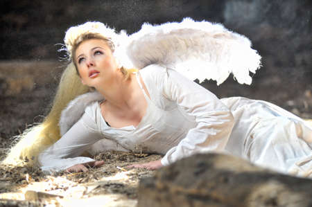 Beautiful angel woman lies in theatre photo