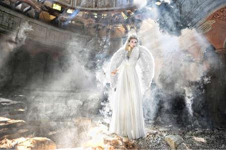 windblown: Beautiful angel woman in theatre