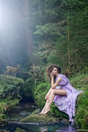 Cute woman in nature scenery photo