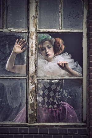 monster movie: A lonely pierrot woman behind the glass Stock Photo