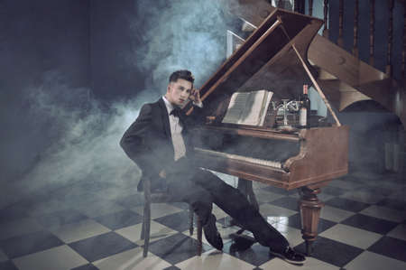 Elegant young man with piano photo