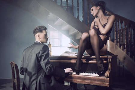 Sexy couple in an intimate situation with piano photo