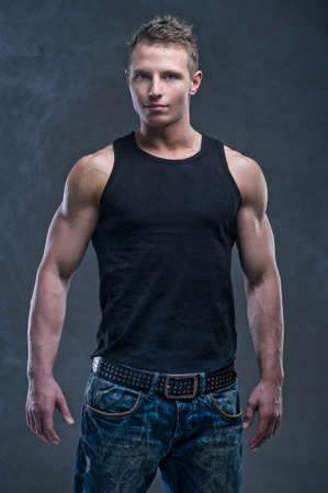 sexy muscular man: Fashion portrait of the young beautiful man