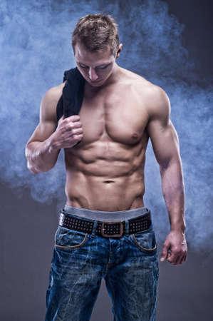 hombre sin camisa: Atleta joven y guapo Foto de archivo