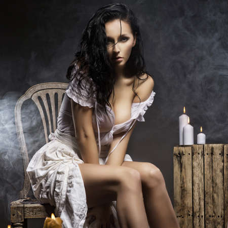 Sad woman with candles photo
