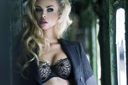 Blonde beauty posing in train Stock Photo