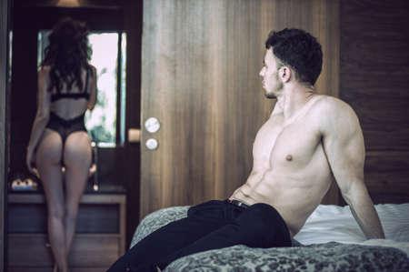 Sexy couple in bedroom photo