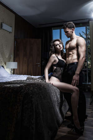 sexy woman on bed: Sexy elegance couple Stock Photo