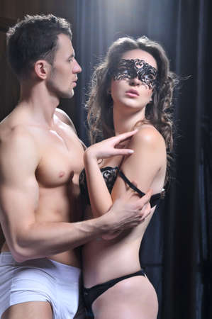 sensuality: Sexy young couple in bedroom Stock Photo