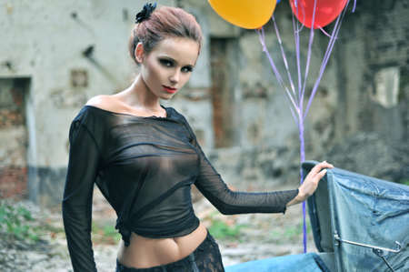 Young sexy woman with balloons photo
