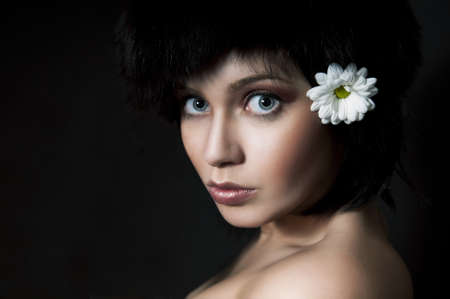 Fashion Brunette Girl with  Flower on Black photo