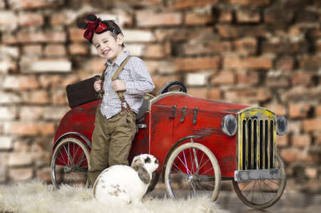 beautiful little boys: A small boy playing with rabbit