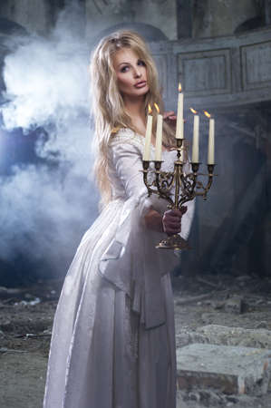 Sexy blonde woman with candelstick photo