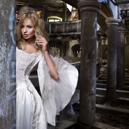 Sensual blonde woman in white dress photo