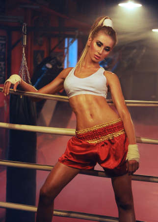 sexy fit blonde woman in boxing ring photo