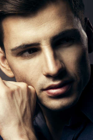 intense: Portrait of handsome young man, sexy guy looking at camera Stock Photo