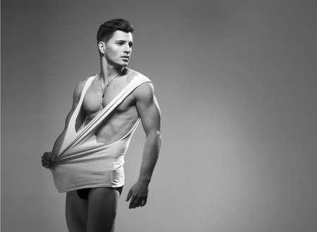 nude sport: Sexy fashion portrait of a hot male model