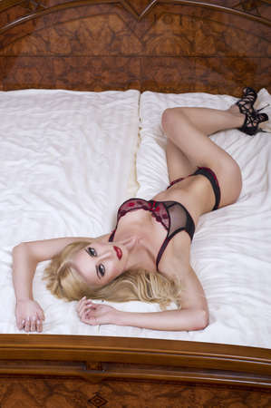 sexy nude blonde: Beautiful lady in lingerie lying in bed