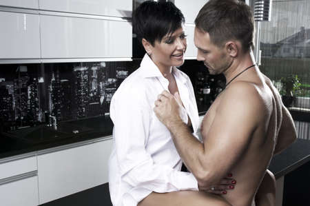 woman sex: Sexy couple in kitchen