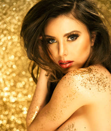 Magic Girl Portrait in Gold. Golden Makeup photo