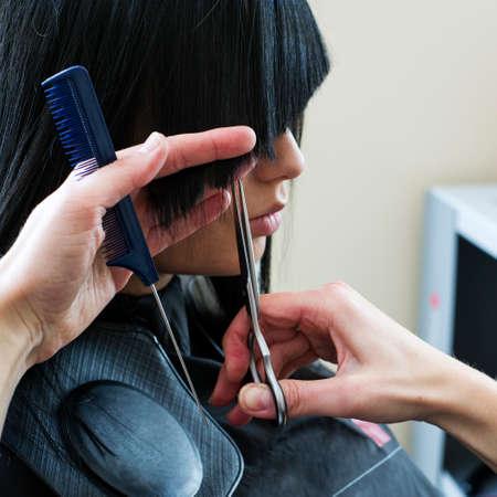 hair do: Woman in hairdressing salon do hair style.
